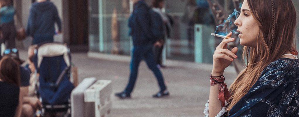woman smoking in the street